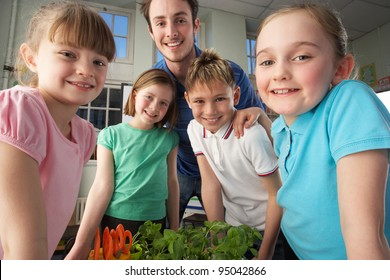 Teacher with children learning about plants