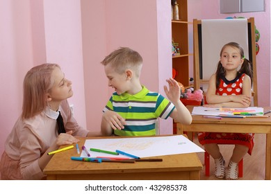 the teacher in the class with a hyperactive child. hyperactive boy. the child indulges in the classroom. misbehaves.hyperactive boy