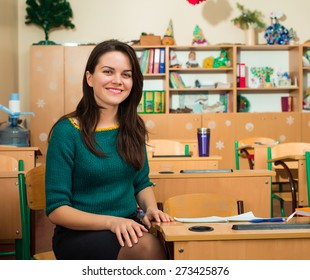 teacher in classroom near desks