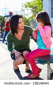 Teacher Comforting Upset Elementary School Pupil