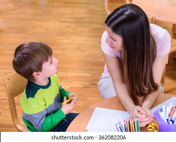 Teacher and cute boy Looking at Each Other - Supporting Child