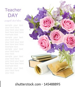 Teacher Day (still life with bunch with bluebells flowers and roses, map and books isolated on white background with sample text)