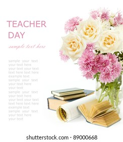 Teacher day (still life with bunch of cream roses, books and map isolated on white)