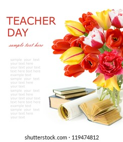 Teacher Day (still life with huge bunch of spring tulips, map and books isolated on white background)