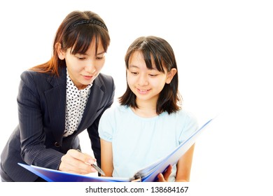 Teacher with girl studying.