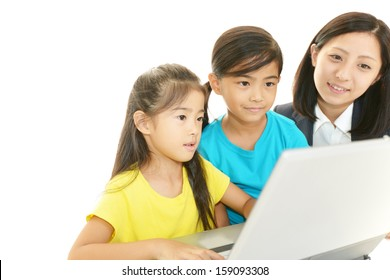 Teacher with girls studying.
