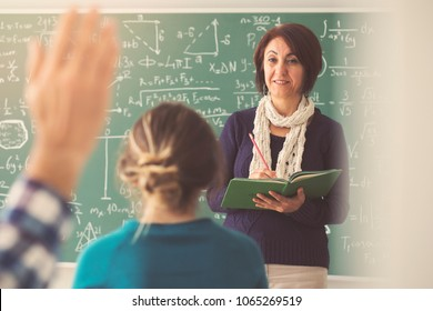 Teacher giving lesson in classroom