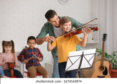 Teacher giving music lessons at school