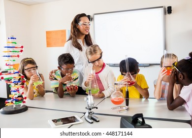 A teacher having science lesson in classroom