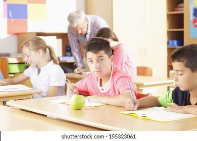 Teacher helping elementary school group