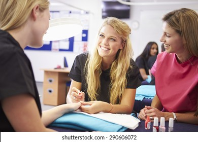 Teacher Helping Students Training To Become Beauticians