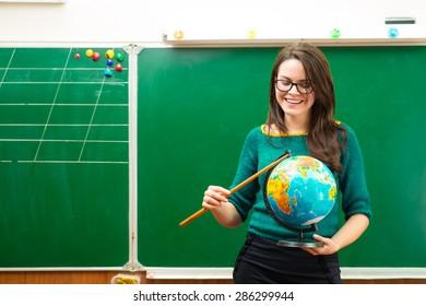 Teacher holding globe in hand