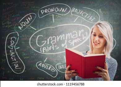 Teacher holding a red book over blackboard background written with chalk english grammar parts of speech. Opportunity for students to learn the system and structure of a language.