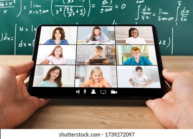 Teacher Hosting Online Class Using Video Conference On Laptop
