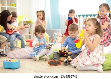 Teacher and kids group during music lesson in preschool