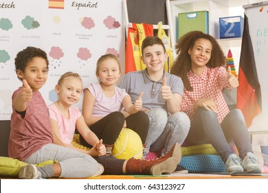 Teacher and kids making ok gesture with thumbs up during lesson/Teacher and kids making ok gesture with thumbs up /Sunny, partly cloudy, cloudy, rainy, snowy, sleeting, icy, tornado, thumde