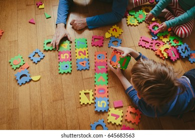 teacher and kids playing with puzzle, early learning