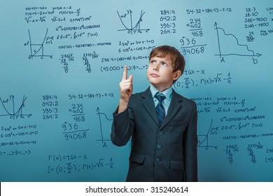 Teacher learned professor teenager boy shows a finger portrait science mathematical formulas math problem Infographics photo studio