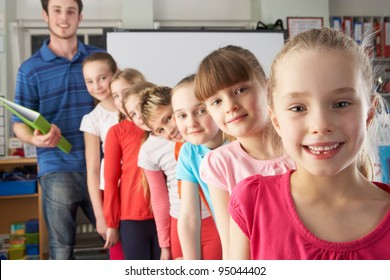 Teacher with line up of children in class