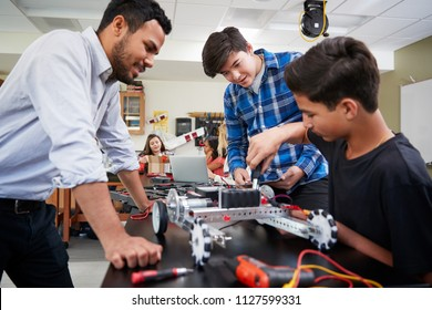 Teacher With Male Pupils Building Robotic Vehicle In Science Lesson - Shutterstock ID 1127599331