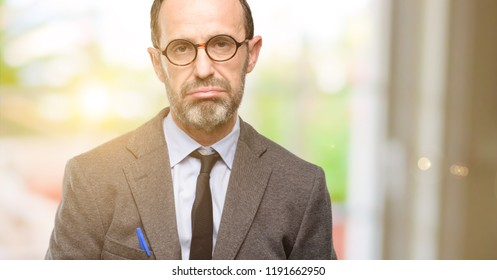 Teacher man using glasses with sleepy expression, being overworked and tired
