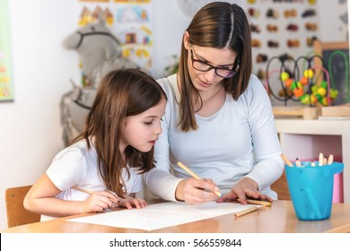 Teacher Mom working with Creative Kid