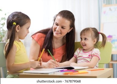 Teacher or mom working with creative kids in kindergarten or home