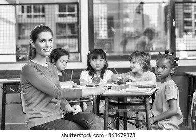 Teacher with multi ethnic elementary classroom.