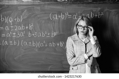 Teacher on school lesson at blackboard. Back to school. Teachers day. Study and education. Modern school. Knowledge day. woman in classroom. Home schooling. serious woman.  Cramming before an exam.