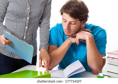 A teacher pointing a college student his mistake