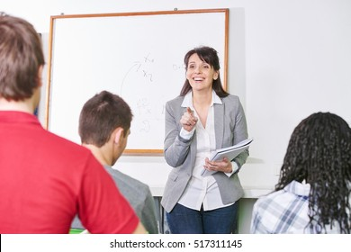 Teacher points a student with her finger at a high school class