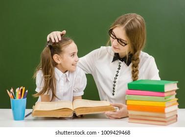the teacher praises her student