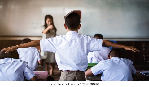Teacher punish the offending students-extend the arms - Image