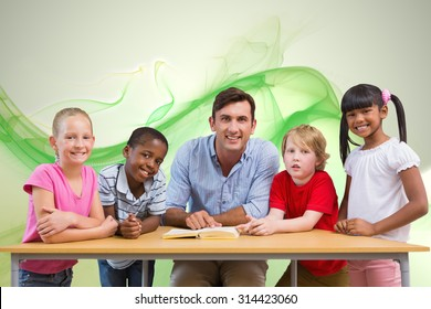 Teacher and pupils smiling at camera at library against green abstract design