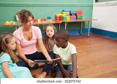 Teacher reading a book to her kindergarten class