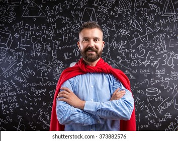 Teacher in red cape against big blackboard with mathematical sym