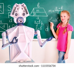 Teacher robot with schoolchild girl in school class next to blackboard. Interactive ai online learning future for kids concept.