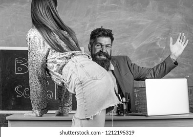Teacher or school principal punishes slapping buttocks sexy student. Student in mini skirt with sexy buttocks waits for punishment. Role game concept. School behaviour discipline and punishment.