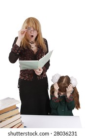Teacher is shocked at schoolgirl's homework. Woman in shock. Young beautiful teacher portrait with her student in classroom. Isolated on white in studio.