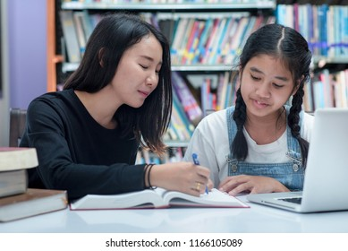 Teacher and student Asia.teacher and girl at laptop