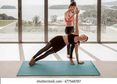 Teacher and student athletic woman practicing yoga outdoor, Asia woman study yoga fitness exercise for relax and healthy over ocean andaman sea view and blue sky. Concept outdoor sport and health
