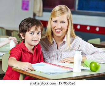 Teacher and student in classroom of an elementary school