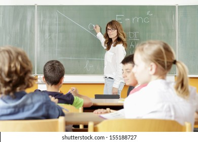 Teacher and student in the classroom at school.