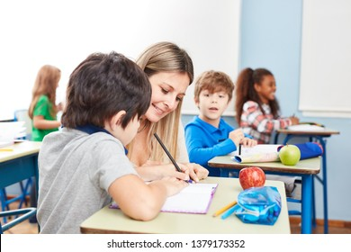 Teacher with student at homework help or tutoring