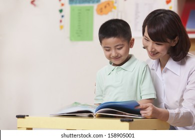 Teacher and student reading