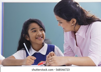 teacher and student smile at each other