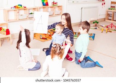 Teacher teaches preschoolers