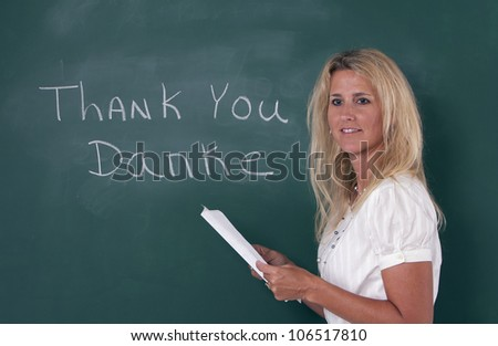 teacher teaching foreign language by chalkboard stock photo edit