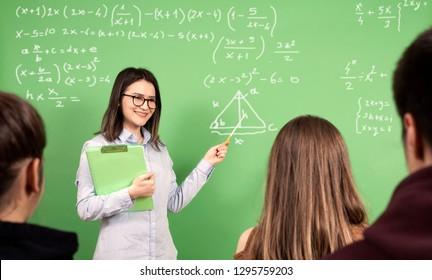 teacher teaching mat at blackboard