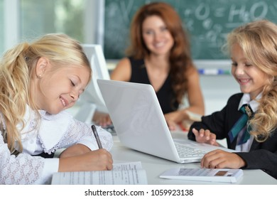 teacher with two girls in school